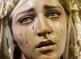 A wooden carving of Virgin of the Seven Sorrows is displayed in a church in the Andalusian capital of Seville